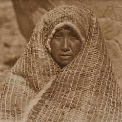 Nootka Woman Wearing Cedar Bark Blanket (1915)